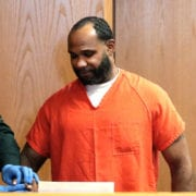 Laster, 43, of Lakeland, gets fingerprinted Monday after being sentenced to life in prison for attempted second-degree murder.