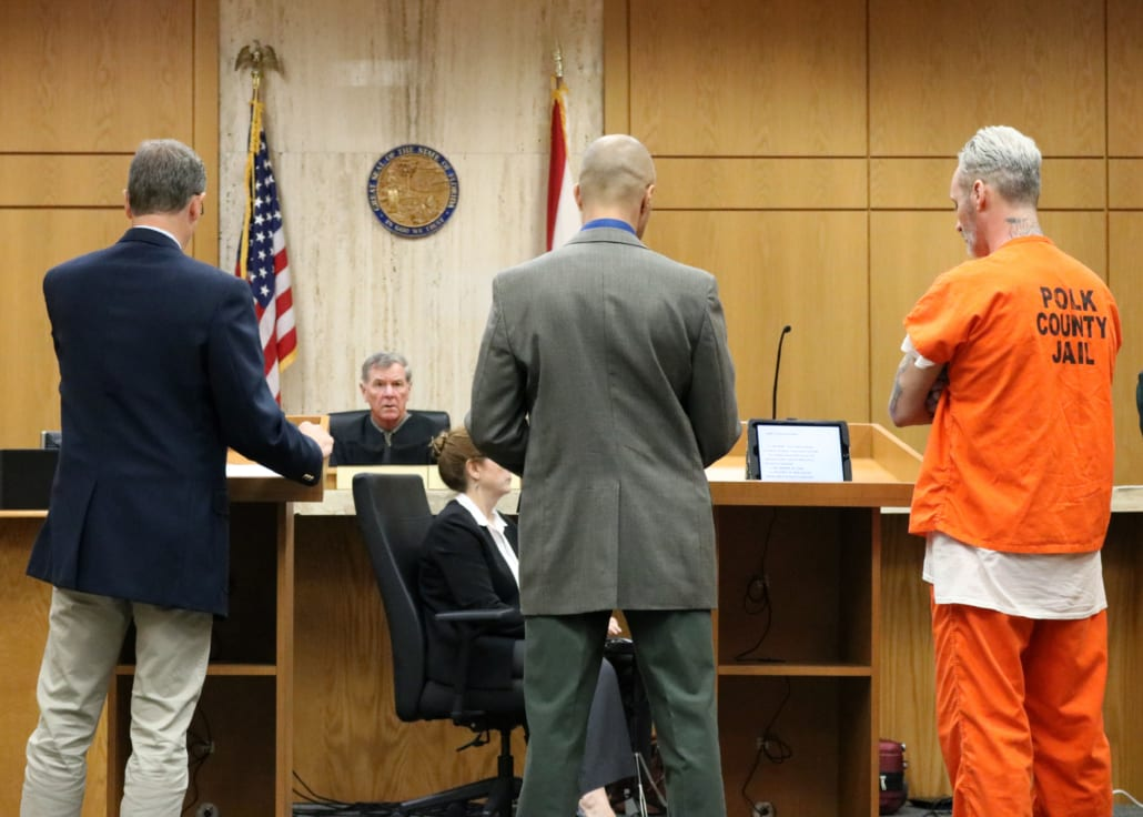 Patrick Rayha, right, stands in front of Judge Maloney during his sentencing hearing Wednesday morning. He was given a mandatory life sentence for the 2017 murder of Russell Jackson.
