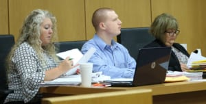 Ronald Wagoner sits with his defense team.